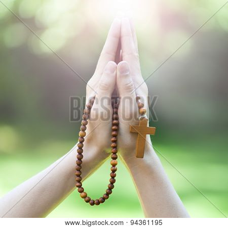 Rosary in hands, religious background