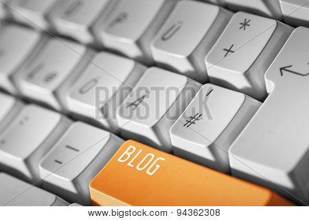 Blog business concept -Orange button or key on white keyboard