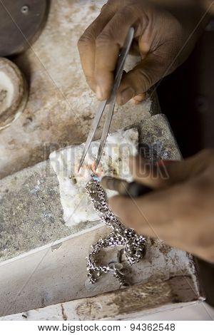 Varanasi, India - May: Jeweler Making Jewelry. Handwork. May 15, 2015 In Varanasi, India. Jewelcraft