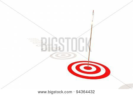 Arrow Hitting The Center Of A Red Target