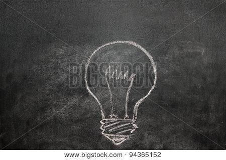 Light Bulb On A Black Chalkboard