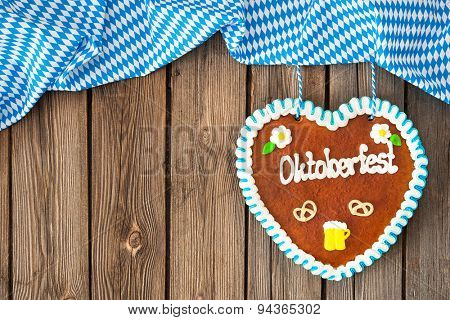 Gingerbread heart on wooden background