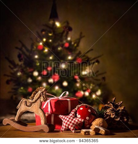 Gifts and decorations with Christmas tree in background