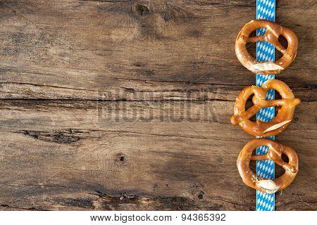 Bavarian pretzels on old wooden background for Oktoberfest