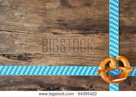 Pretzel on old wooden background for Oktoberfest