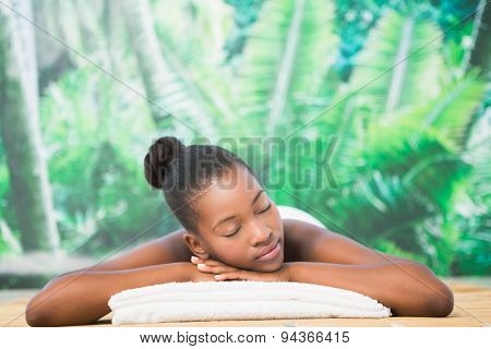 Pretty woman lying on massage table at the health spa
