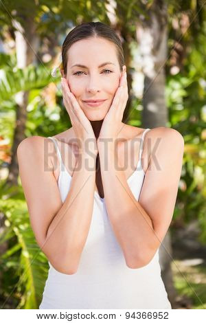 Beautiful young woman looking at camera on gree background