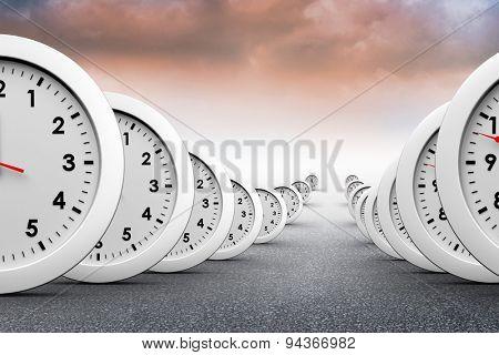 Clocks against cloudy landscape background
