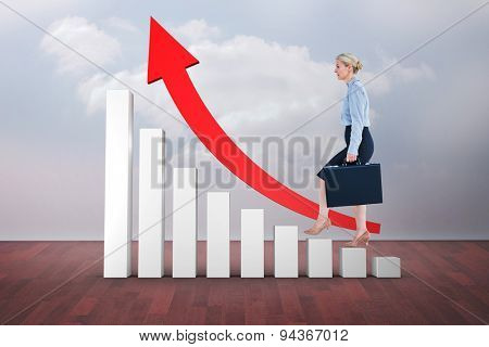 Businesswoman climbing with briefcase against clouds in a room