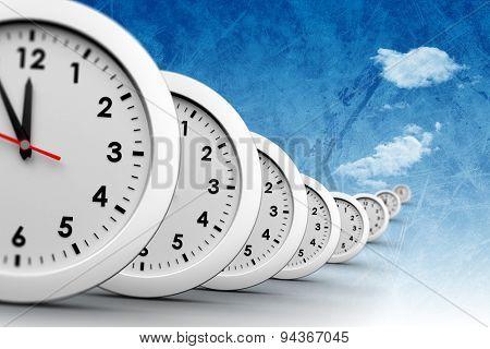 Clocks against painted sky