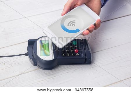Wifi connectin against man using smartphone to express pay