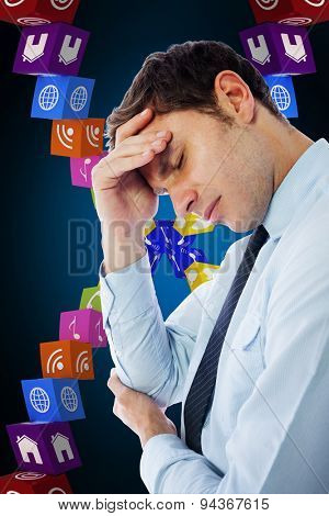 Businessman with a headache against blue background with vignette