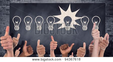 Hands showing thumbs up against composite image of black card