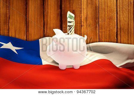 Dollar in piggy bank against wooden planks