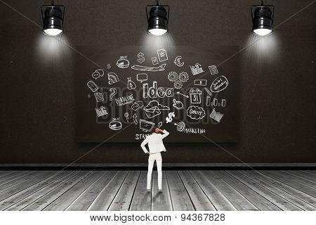 Thinking businesswoman against blackboard