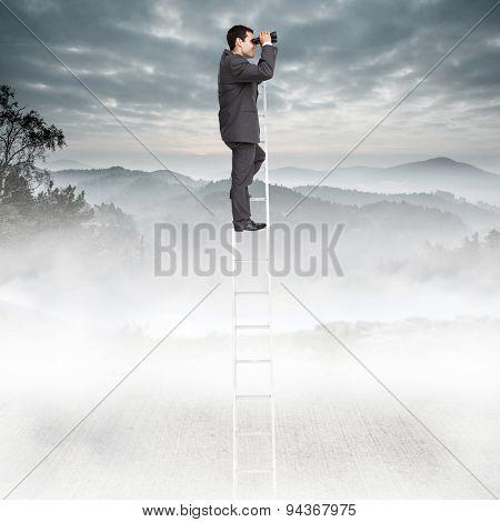 Businessman standing on ladder using binoculars against misty forest