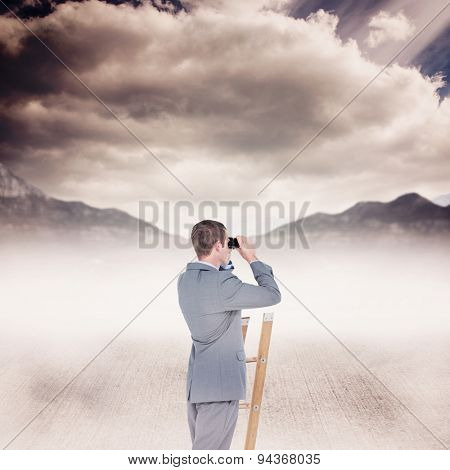Businessman looking on a ladder against cloudy sky