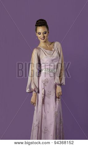 Regal brunette woman in chiffon pink dress