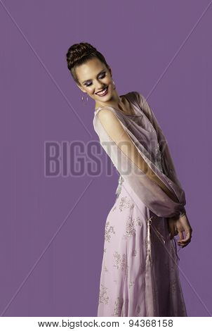 Happy woman in pink dress smiling
