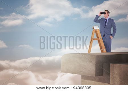 Businessman looking on a ladder against view from balcony into bright sky