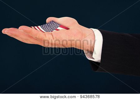 Businessman with wrist watch and hands out against blue background