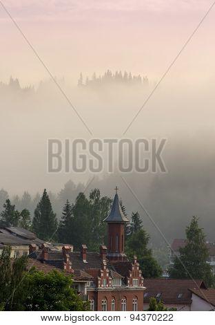 Roofed Houses Scene In The Mountain Fog.vladimir House From Vatra Dornei