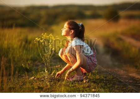 Girl Inhales Aroma Of A Wildflower