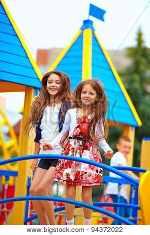 Cute Happy Girls Jumping On Toy Castle Playground