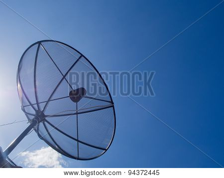 Satellite Dish Transmission Data On Bright Blue Sky Background.