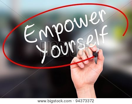 Man Hand writing Empower Yourself with black marker on visual screen.