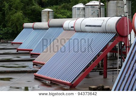 solar panels powering heated water placed on rooftops