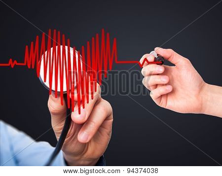 Closeup portrait doctor hand listening to heart beat in heart shape with stethoscope.