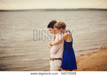 Romantic Couple Hugging Near A Lake. Waterscape