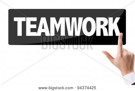 Businessman pressing button with the text: Teamwork