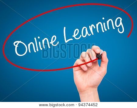 Man Hand writing Online Learning with black marker on visual screen.