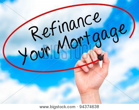Man Hand writing Refinance Your Mortgage with black marker on visual screen.