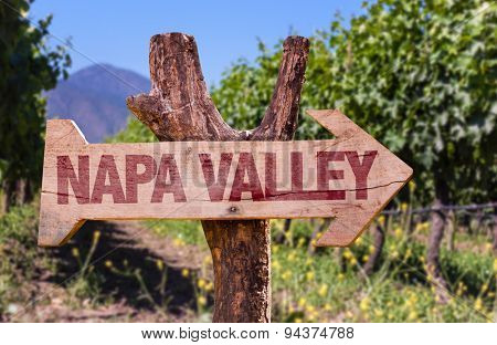 Napa Valley wooden sign with winery background