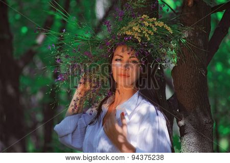 wreath of flowers on head of girl. outdoor shot