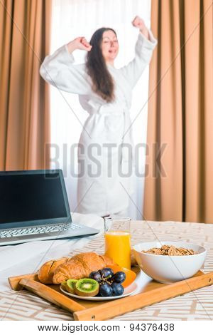 Breakfast In Bed And Stretches Himself A Woman In A Bathrobe