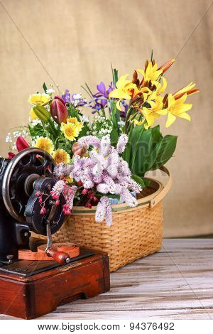 Flower arrangement with old black sewing-machine