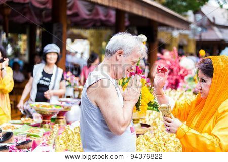 CHIANG MAI, THAILAND - CIRCA MAY 2014 : Tourist at a ceremony in Wat Prathat Doi Suthep temple, Chiang Mai, Thailand.