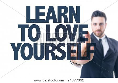 Business man pointing the text: Learn to Love Yourself