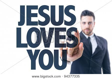 Business man pointing the text: Jesus Loves You