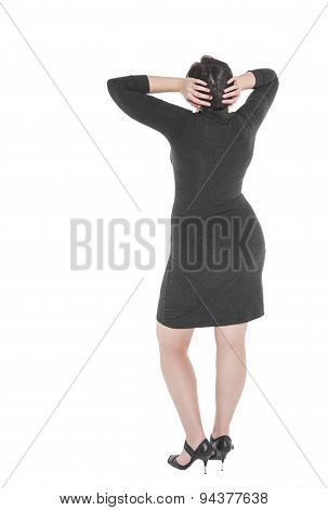 Plus Size Woman Standing And Looking On Something. Back Pose