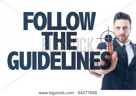 Business man pointing the text: Follow the Guidelines