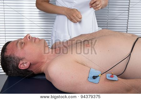 Close-up Of Electrodes On Arm To Massage The Biceps