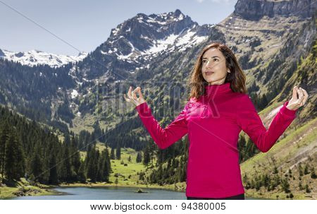 Woman Meditating In Nature Outdoors In Spring