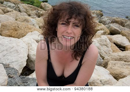 Close-up Of A  Woman On The Beach Smiling