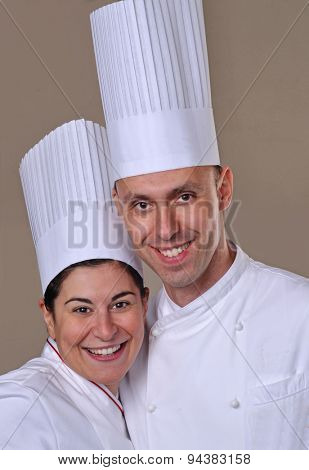 Young cook couple portrait.