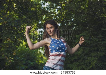 Model Woman In A T-shirt With The American Flag